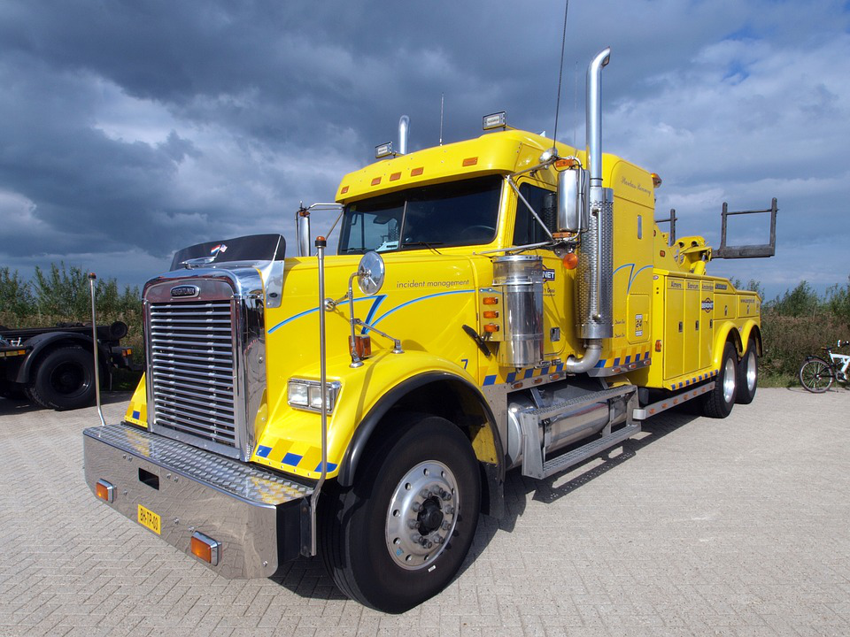 A yellow towing truck